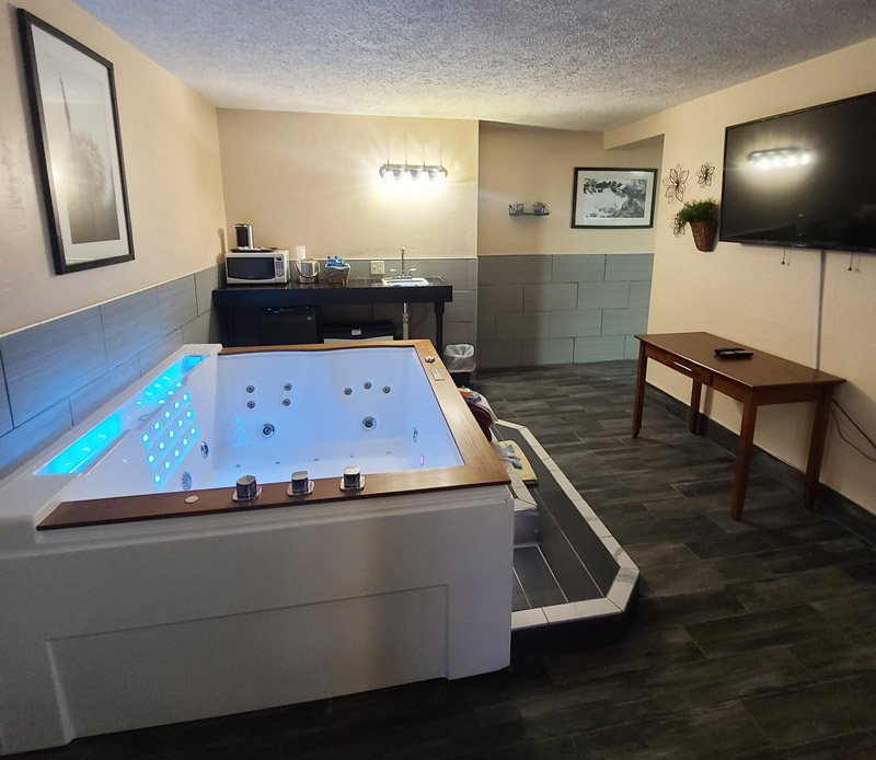 Our new Executive Jacuzzi suites feature a large 80-gallon Jacuzzi tub with LED lighting, waterfall and bluetooth for radio or your device's playlist – plus a large sitting area and mini-kitchen with microwave, mini-fridge and wet bar.