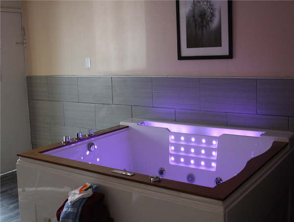 Our new Executive Jacuzzi suites feature a large 80-gallon Jacuzzi tub LED lighting, waterfall and bluetooth for radio or your device's playlist.