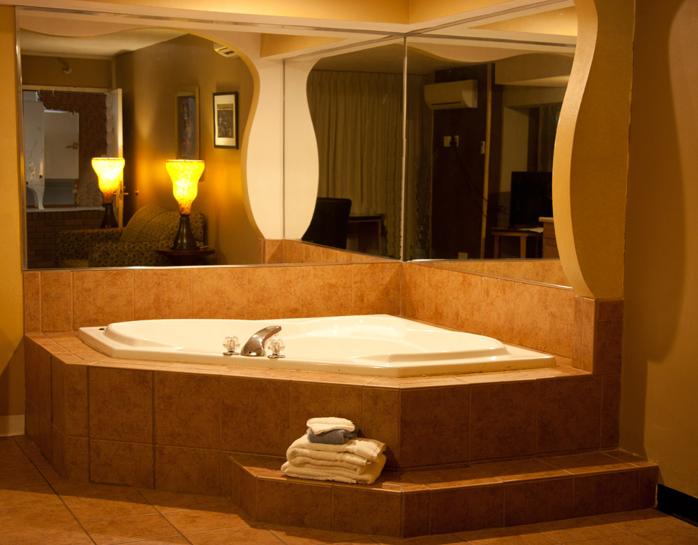 Jacuzzi suites feature a large Jacuzzi tub with a large sitting area and mini-kitchen with microwave, mini-fridge and wet bar.